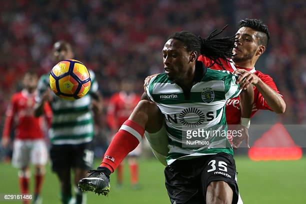 Sporting's defender Ruben Semedo fights for the ball with Benfica's forward Raul Jimenez during the Portuguese League football match SL Benfica vs...