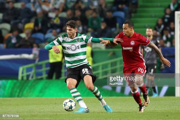 Sporting's defender Tobias Figueiredo from Portugal vies with Olympiacos' Colombian midfielder Felipe Pardo during the UEFA Champions League group D...