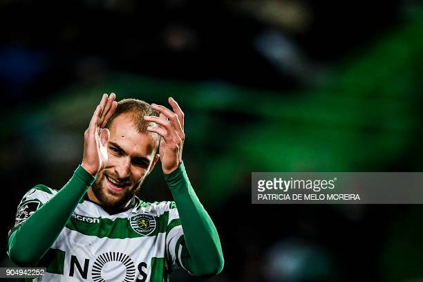 Sporting's Dutch forward Bas Dost applauds during the Portuguese league football match between Sporting CP and CD Aves at the Jose Alvalade stadium...