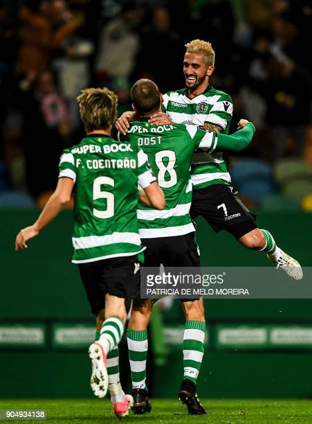 Sporting's Dutch forward Bas Dost celebrates a goal with Sporting's midfielder Ruben Ribeiro and Sporting's defender Fabio Coentrao during the...