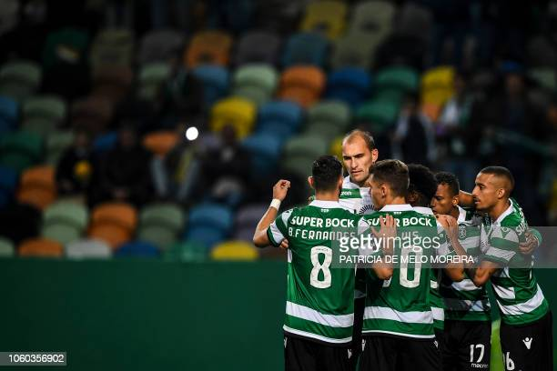 Sporting's Dutch forward Bas Dost celebrates a goal with teammates during the Portuguese league football match between Sporting CP and GD Chaves at...