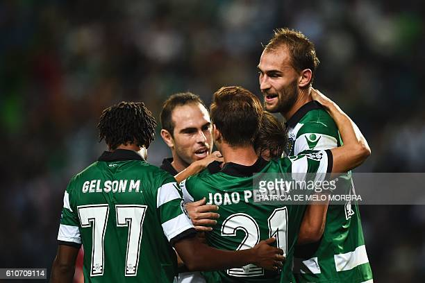Sporting's Dutch forward Bas Dost celebrates a goal with teammates during their UEFA Champions League football match between Sporting CP and Legia...