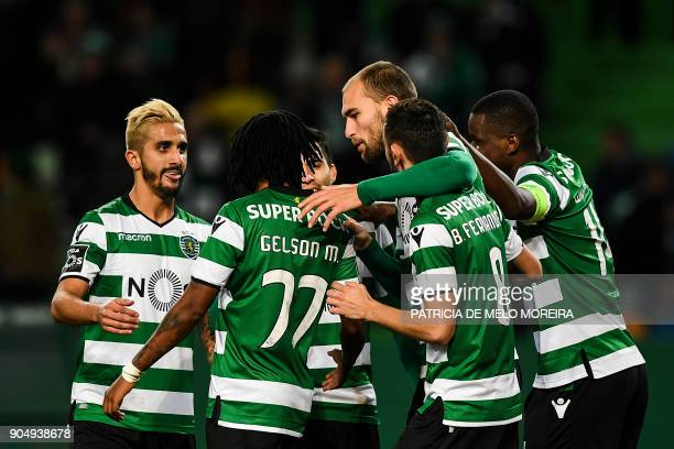 Sporting's Dutch forward Bas Dost celebrates a goal with teammates during the Portuguese league football match between Sporting CP and CD Aves at the...