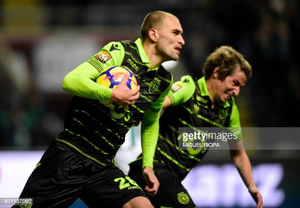 Sporting's Dutch forward Bas Dost celebrates after scoring a goal during the Portuguese Cup final football match between Vitoria FC and Sporting CP...