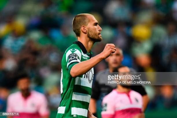 Sporting's Dutch forward Bas Dost celebrates after scoring against GD Chaves during the Portuguese league football match Sporting CP vs GD Chaves at...
