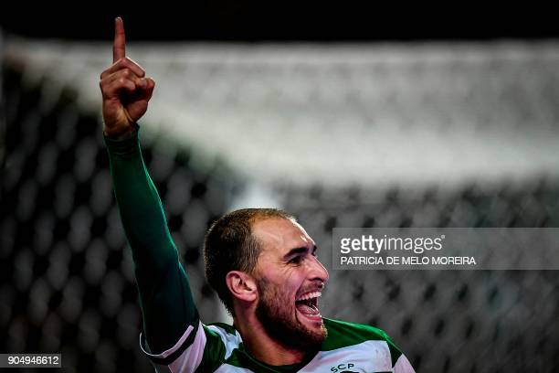 Sporting's Dutch forward Bas Dost celebrates scoring a hat trick during the Portuguese league football match between Sporting CP and CD Aves at the...