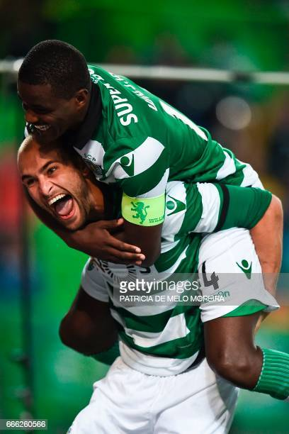 Sporting's Dutch forward Bas Dost celebrates with his teammate Sporting's midfielder William de Carvalho after scoring during the Portuguese league...
