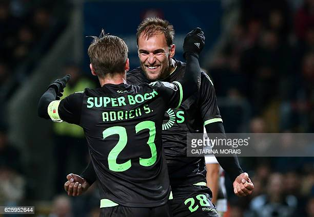 Sporting's Dutch forward Bas Dost celebrates with Sporting's midfielder Adrien Silva after scoring a goal during the Portuguese league football match...