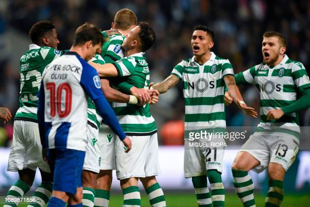 Sporting's Dutch forward Bas Dost celebrates with teammates after scoring a penalty during the Portuguese Taca da Liga or League Cup final football...