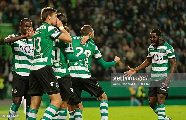 Sporting's Dutch forward Bas Dost celebrates with teammates after scoring during the Portuguese league football match Sporting CP vs FC Arouca at the...