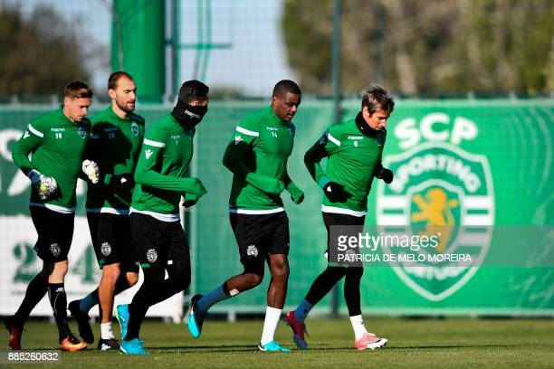 Sporting's Dutch forward Bas Dost French goalkeeper Romain Salin Portuguese goalkeeper Rui Patricio Portuguese midfielder William de Carvalho and...