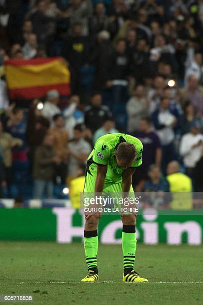Sporting's Dutch forward Bas Dost reacts after Real Madrid scored their winning goal the UEFA Champions League football match Real Madrid CF vs...