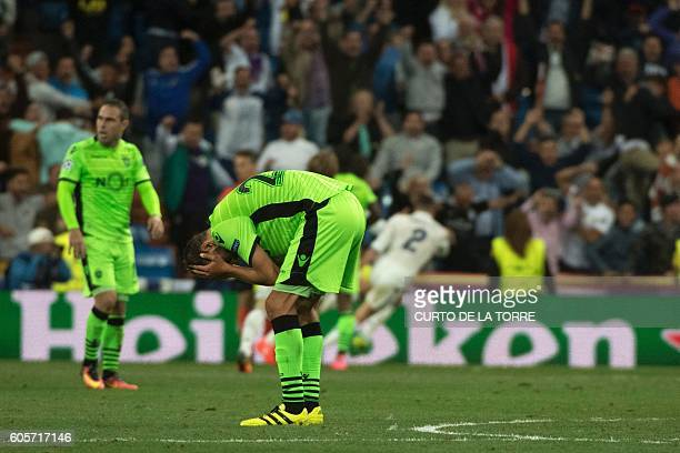 Sporting's Dutch forward Bas Dost reacts after Real Madrid scored their winning goal during the UEFA Champions League football match Real Madrid CF...