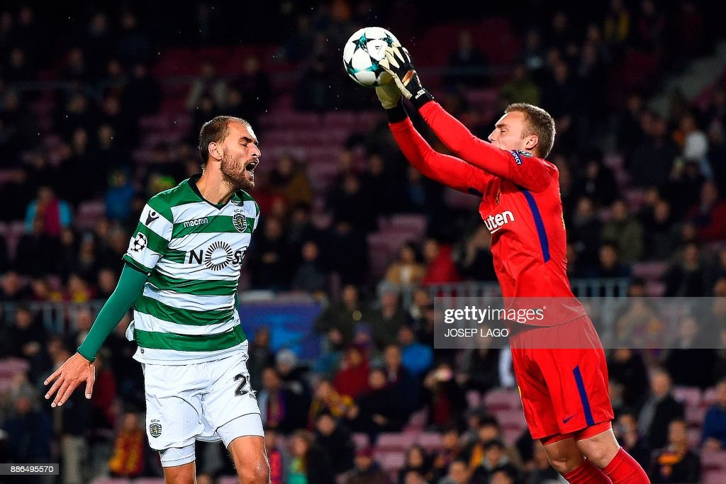 Sporting's Dutch forward Bas Dost (L) reacts as his shot on goal is saved by Barcelona's Dutch goalkeeper Jasper Cillessen during the UEFA Champions League football match FC Barcelona vs Sporting CP at the Camp Nou stadium in Barcelona on December 5, 2017. / AFP PHOTO / Josep LAGO