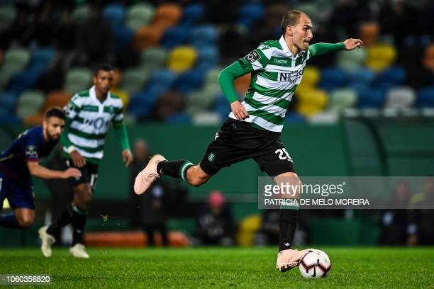 Sporting's Dutch forward Bas Dost shoots a penalty kick to score a goal during the Portuguese league football match between Sporting CP and GD Chaves...