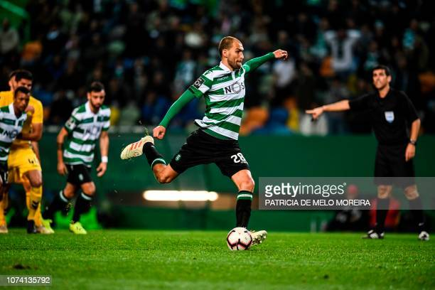 Sporting's Dutch forward Bas Dost shoots a penalty kick to score a goal during the Portuguese League football match between Sporting Lisbon and...