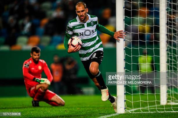 Sporting's Dutch forward Bas Dost takes the ball after scoring a goal during the Portuguese League football match between Sporting Lisbon and...