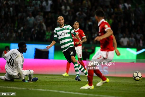 Sporting's Dutch forward Bas Dost vies with Benfica's goalkeeper Bruno Varela during the Portuguese League football match between Sporting CP and SL...
