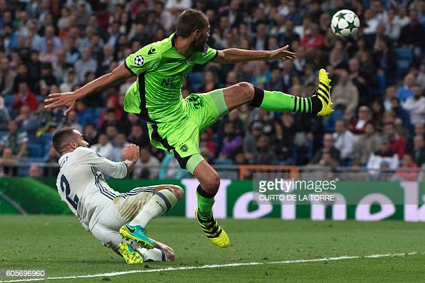 Sporting's Dutch forward Bas Dost vies with Real Madrid's defender Dani Carvajal during the UEFA Champions League football match Real Madrid CF vs...