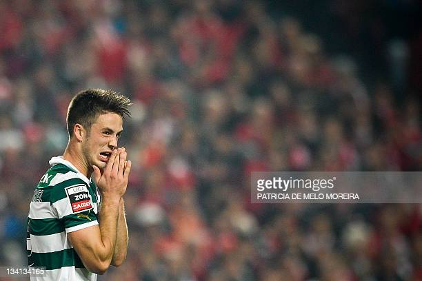Sporting's Dutch forward, Van Wolfswinkel reacts after missing a goal kick against Benfica during their Portuguese league football match at the Luz...