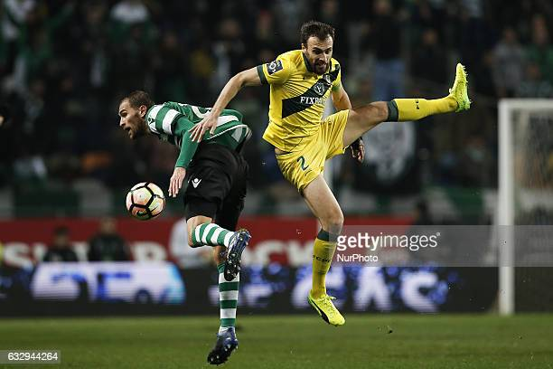 Sporting's forward Bas Dost vies for the ball with Pacos Ferreira's midfielder Marco Baixinho during Premier League 2016/17 match between Sporting CP...