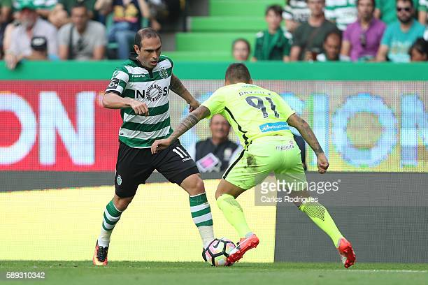 Sporting's forward Bruno Cesar from Brazil tries to pass trough Maritimo's defender Patrick from Brazil during the Portuguese Primeira Liga between...