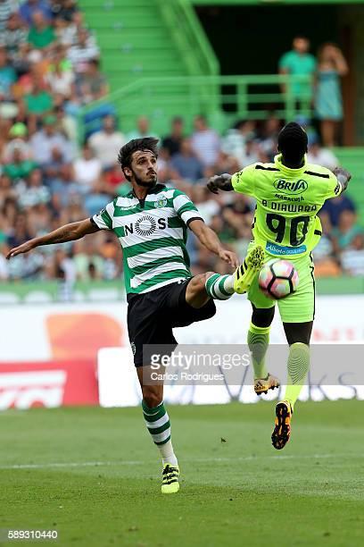 Sporting's forward Bryan Ruiz from Costa Rica vies with Maritimo's forward Baba Diawara from Camaroes during the Portuguese Primeira Liga between...