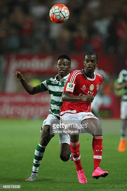 Sporting's forward Carlos Mane vies with Benfica's defender Nelson Semedo during the Portuguese Super Cup match between SL Benfica and Sporting CP at...
