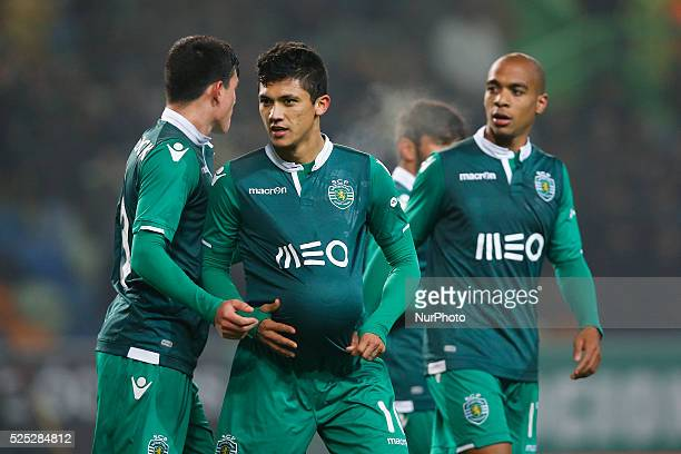 Sporting's forward Fredy Montero celebrates his goal with Sporting's defender Jonathan Silva and Sporting's midfielder Joao Mario during the...