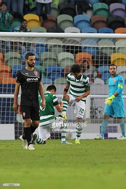 Sporting's forward Fredy Montero celebrates scoring Sporting's second goal with Sporting's defender Jonathan Silva during the match between Sporting...