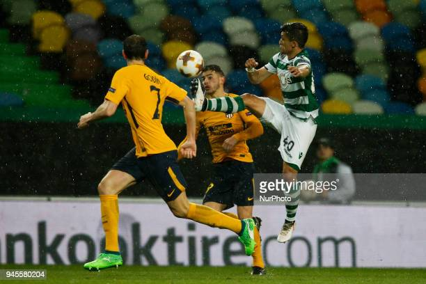 Sporting's forward Fredy Montero vies for the ball with Atletico Madrid's defender Lucas Hernandez and Atletico Madrid's defender Diego Godin during...