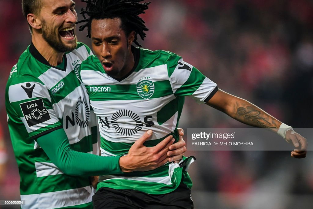 Sporting's forward Gelson Martins (R) celebrates a goal with Sporting's Dutch forward Bas Dost during the Portuguese league football match SL Benfica vs Sporting CP at the Luz stadium in Lisbon on January 3, 2018. /