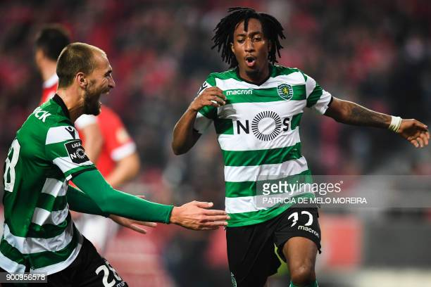 Sporting's forward Gelson Martins celebrates a goal with Sporting's Dutch forward Bas Dost during the Portuguese league football match SL Benfica vs...