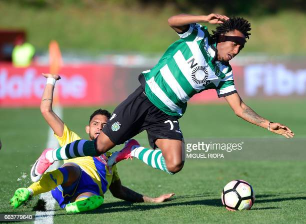 Sporting's forward Gelson Martins vies with Arouca's Brazilian midfielder Adilson Goiano during the Portuguese league football match Arouca FC vs...