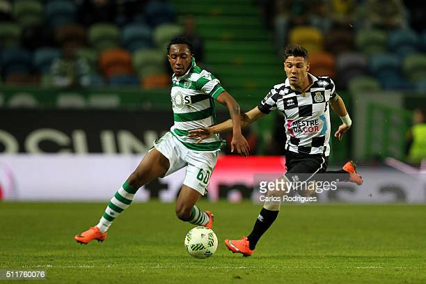 Sporting's forward Gelson Martins vies with Boavista's midfielder Mario during the match between Sporting CP and Boavista FC for the Portuguese...