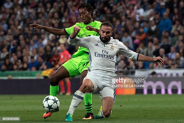 Sporting's forward Gelson Martins vies with Real Madrid's defender Dani Carvajal during the UEFA Champions League football match Real Madrid CF vs...