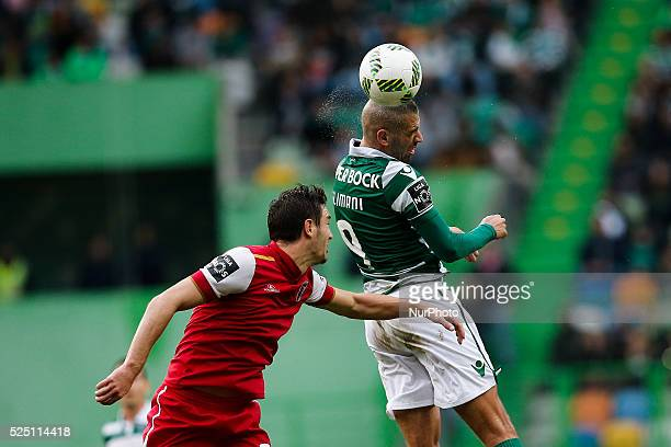 Sporting's forward Islam Slimani heads for the ball with Braga's midfielder Vukcevic during the Portuguese League football match between Sporting CP...