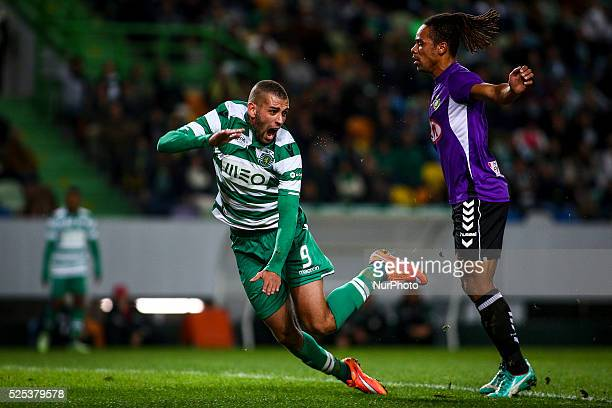 Sporting's forward Islam Slimani struggles with Setubal's forward Manu during the Portuguese League football match between Sporting CP and Vitoria...
