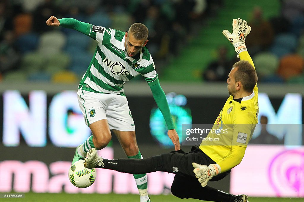 Sporting's forward Islam Slimani (L) tries to pass trough Boavista's goalkeeper Mika(D) during the match between Sporting CP and Boavista FC for the Portuguese Primeira Liga at Jose Alvalade Stadium on February 22, 2016 in Lisbon, Portugal.