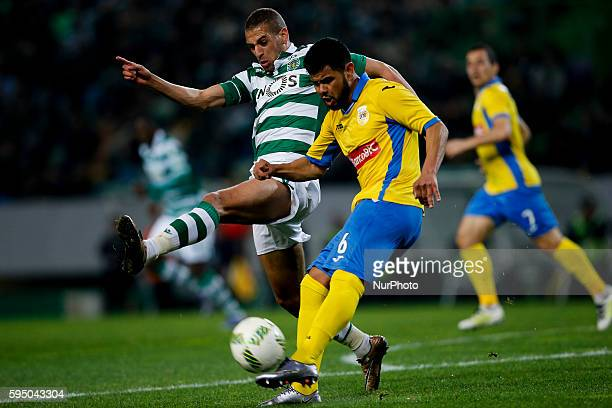 Sporting's forward Islam Slimani vies for the ball with Arouca's defender Lucas Lima during the Portuguese League football match between Sporting CP...