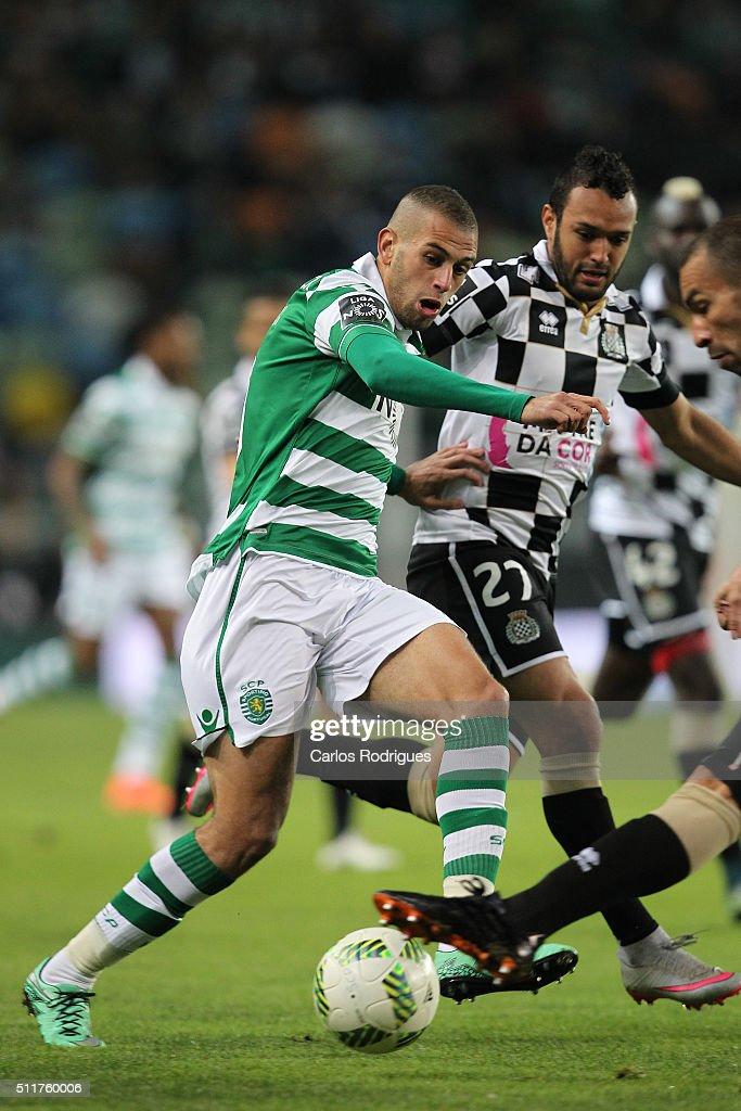 Sporting's forward Islam Slimani (L) vies with Boavista's midfielder Anderson Carvalho (D) during the match between Sporting CP and Boavista FC for the Portuguese Primeira Liga at Jose Alvalade Stadium on February 22, 2016 in Lisbon, Portugal.