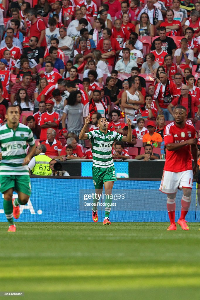 Sporting's forward Islam Sliming celebrates scoring Sporting's goal during the Primeira Liga match between SL Benfica and Sporting CP at Estadio da Luz on August 31, 2014 in Lisbon, Portugal. (Photo by Carlos Rodrigues/Getty Images).