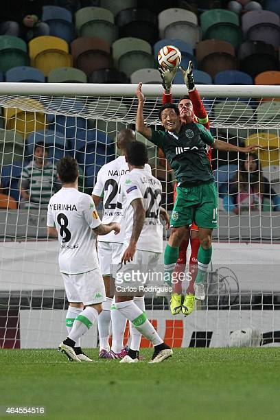 Sporting's forward Junya Tanaka vies with Wolfsburg's goalkeeper Diego Benaglio in action during the UEFA Europa League Round of 32 match between...
