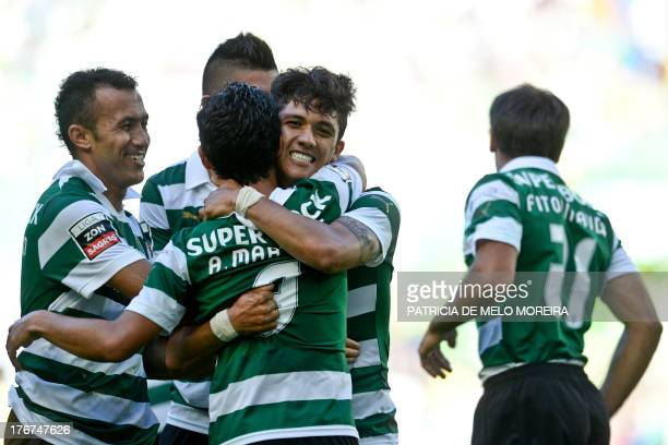 Sporting's forward Montero celebrates with his teammates after scoring against Arouca during the Portuguese league football match Sporting CP vs FC...