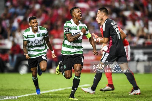 Sporting's forward Nani celebrates a goal during the Portuguese league football match between SL Benfica and Sporting CP at the Luz stadium in Lisbon...