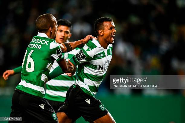 Sporting's forward Nani celebrates a goal with Sporting's defender Bruno Gaspar and Sporting's Colombian forward Fredy Montero during the Portuguese...