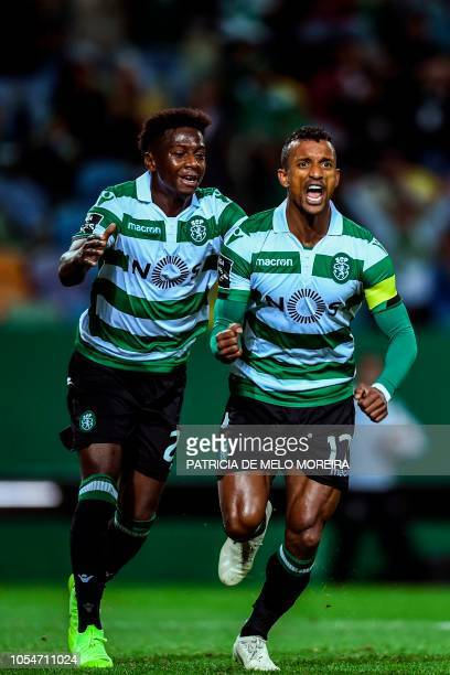 Sporting's forward Nani celebrates a goal with teammate Sporting's Malayan forward Abdoulay Diaby during the Portuguese league football match between...