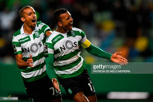TOPSHOT Sporting's forward Nani celebrates a goal with teammate Sporting's defender Bruno Gaspar during the Portuguese league football match between...