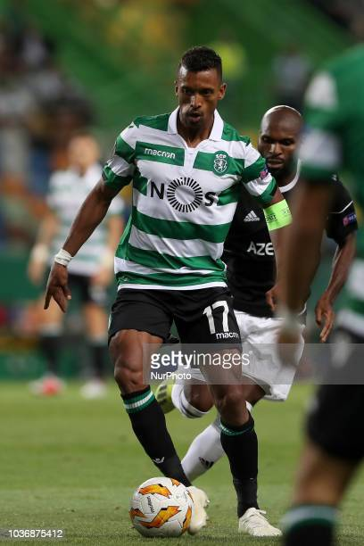 Sporting's forward Nani from Portugal vies with Qarabag's forward Innocent Emeghara during the UEFA Europa League Group E football match Sporting CP...