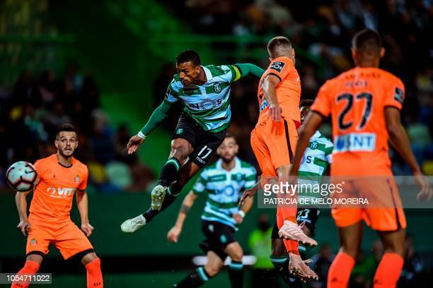 TOPSHOT Sporting's forward Nani heads the ball and scores a goal during the Portuguese league football match between Sporting CP and Boavista FC at...